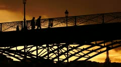 Pont des Art, at sunset in Paris Stock Footage