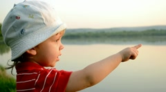 A  boy  on the shore of the lake Stock Footage