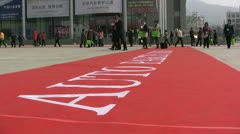Red carpet on the 'Auto parts fair' in Qingdao, China - stock footage