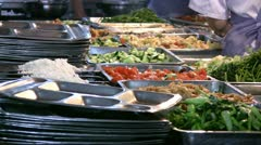 Plates with food in a school canteen in China Stock Footage