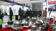 People at a car parts show in China Stock Footage