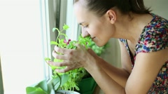 Woman smells the aroma herbs in her kitchen HD Stock Footage