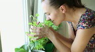 Stock Video Footage of Woman smells the aroma herbs in her kitchen HD