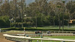 HORSES ROUND TURN ON DIRT Stock Footage
