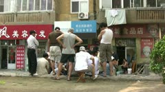 Playing cards on the backstreets of Qingdao, China - stock footage