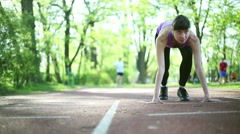 Young beautiful woman preparing to run, dolly shot HD Stock Footage