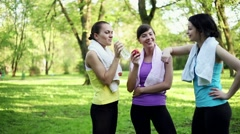 Stock Video Footage of Happy female friends resting after sport activity, dolly shot HD