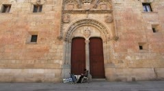 Spain Salamanca university with seated man Stock Footage