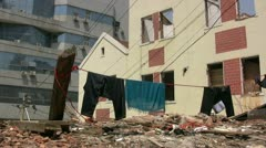 Washing line at a demolition site in China Stock Footage