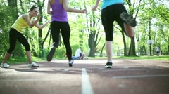 Two young women running on the track, dolly shot HD Stock Footage
