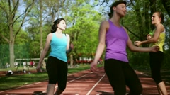 Stock Video Footage of Women running on the track, and drinking water after finish, dolly shot HD