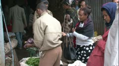 Addis Ababa Ethiopia Market woman buying peppers seller puts in plastic bag MS - stock footage