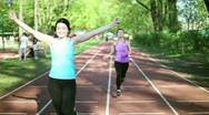 Stock Video Footage of Two young women running on track lane, slow motion HD