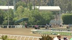 RACEHORSES AROUND FINAL TURN SLO-MO Stock Footage