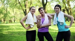 Female friends resting after sport workout, dolly shot HD Stock Footage