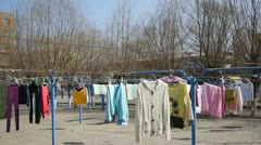 Colorful Clothes Drying In The Sun Stock Footage