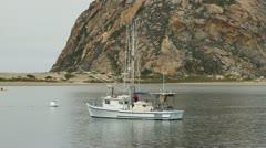 Morro Bay Fishing boat cruises slowly - stock footage