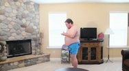 Fat naked man dancing with headphones and ipod 1.mp4 Stock Footage