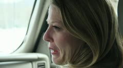 Pretty woman in the passenger seat of a car or SUV Talking to Driver  7.mp4 Stock Footage
