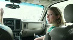 Pretty woman in the passenger seat of a car or SUV Talking to Driver  1.mp4 Stock Footage