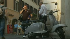 Stock Video Footage of Scooter near Cartier shop in Rome