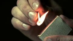 Man lights a match in slow motion Stock Footage