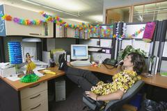 Businessman with hawaiian decorated office Stock Photos