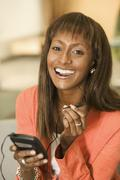 Young woman using hands-free device Stock Photos