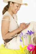 Woman writing on electronic organizer Stock Photos