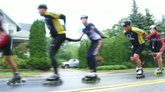 Rollerbladers Zoom By Stock Footage