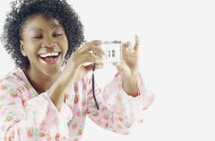 Woman taking self-portrait with camera Stock Photos