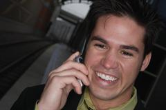 Businessman talking on his cell phone Stock Photos