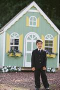 Boy in front of toy house Stock Photos