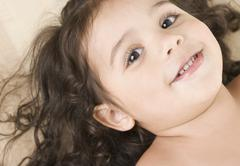 Close up portrait of little girl smiling Stock Photos