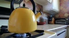 Tea Kettle on Stovetop Stock Footage