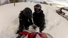 Snowmobile stuck in the snow 2.mp4 Stock Footage