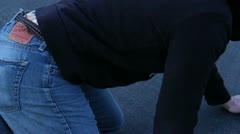Hurt man kneeling on the ground 1 1.mp4 Stock Footage