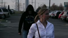 Blonde woman in a parking lot being stalked by a preditor 8.mp4 Stock Footage