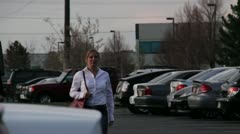 Blonde woman in a parking lot being stalked by a preditor 5.mp4 Stock Footage