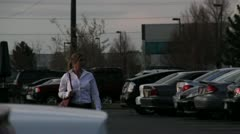 Blonde woman in a parking lot being stalked by a preditor 4.mp4 Stock Footage