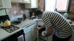 Man Cleans Kitchen Sped Up Stock Footage