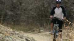 Guy riding a bike with a blue helmet 4.mp4 Stock Footage