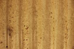 Yellow wavy wall texture - stock photo
