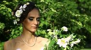 Pensive woman with flowers Stock Footage