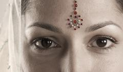 Portrait of young woman with bindi Stock Photos