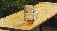 Beer mug in rain Stock Footage