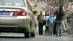 Taking a family picture on the streets of Qingdao, China - stock footage