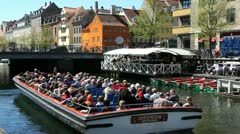 Christianshavns Canal with a sightseeingboat - stock footage