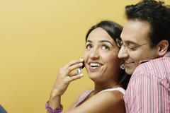 Smiling couple with mobile phone Stock Photos