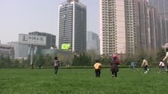 Chinese children are playing with kites in an urban scene Stock Footage